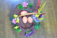 Três ovos na cesta Fotos de Stock Royalty Free