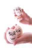 Três ovos nas mãos imagens de stock royalty free