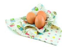 Três ovos no pano bonito Fotografia de Stock Royalty Free