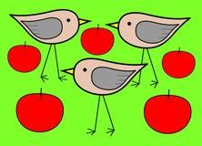 Três pássaros com maçãs Fotografia de Stock
