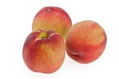 Três pêssegos Imagem de Stock