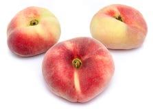 Três pêssegos lisos Foto de Stock Royalty Free