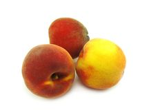 Três pêssegos maduros. Fotos de Stock Royalty Free