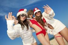 Três Papai Noel feliz que tem o divertimento fotografia de stock royalty free