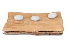 Três pedras em uma madeira do grunge Imagem de Stock Royalty Free