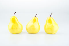 Três peras amarelas Fotos de Stock Royalty Free