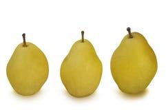 Três peras amarelas isoladas no branco Foto de Stock
