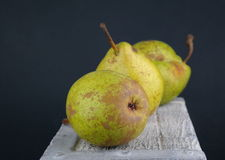 Três peras manchadas Imagem de Stock