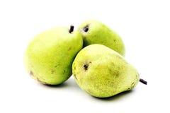 Três peras verdes no fundo branco Fotos de Stock