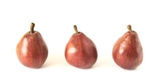 Três peras vermelhas Fotos de Stock Royalty Free