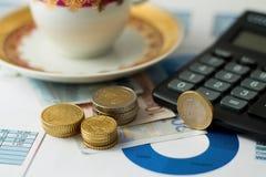 Três pilhas de moedas em outras contas Imagens de Stock Royalty Free