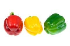 Três pimentas. Fotos de Stock