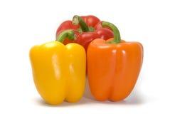 Três pimentas de Bell coloridas Fotografia de Stock