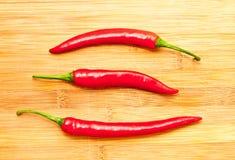 Três pimentas de pimentão vermelho Imagem de Stock Royalty Free