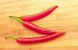 Três pimentas de pimentão vermelho Fotografia de Stock Royalty Free