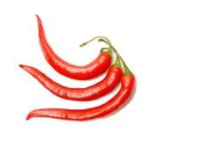 Três pimentas de pimentões vermelhos Foto de Stock