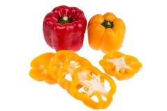 Três pimentas doces em um fundo branco Foto de Stock