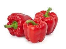 Três pimentas vermelhas. Fotografia de Stock