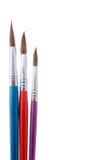 Três pincéis coloridos Foto de Stock