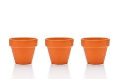 Três potenciômetros de flor da terracota isolados no branco Fotos de Stock Royalty Free