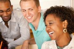 Três povos que jantam para fora Imagens de Stock