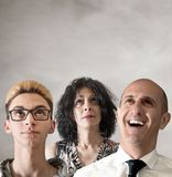 Três povos que olham acima Fotografia de Stock