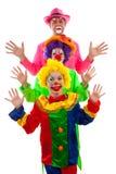 Três povos vestidos acima como do palhaço engraçado colorido Imagem de Stock Royalty Free
