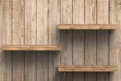 Três prateleiras de madeira na parede Imagem de Stock