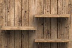Três prateleiras de madeira na parede Imagens de Stock Royalty Free