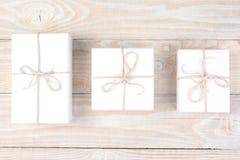 Três presentes brancos Fotografia de Stock Royalty Free
