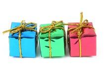 Três presentes coloridos Fotografia de Stock