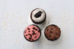 Três queques Fotografia de Stock Royalty Free