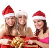 Três raparigas estão tendo uma festa de Natal fotografia de stock royalty free