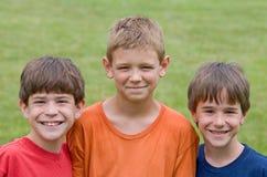 Três rapazes pequenos Fotos de Stock Royalty Free