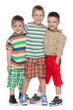 Três rapazes pequenos da fôrma em camisa listrada Imagem de Stock Royalty Free