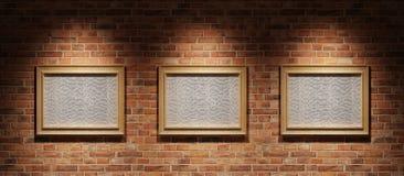 Três retratos em uma parede de tijolo Fotografia de Stock