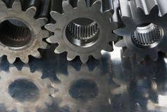 Três rodas denteadas em uma fileira Fotos de Stock