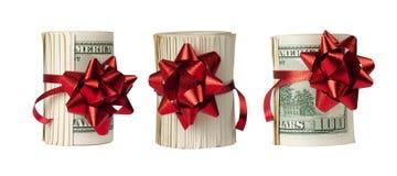 Três rolos de $100 contas Fotografia de Stock Royalty Free