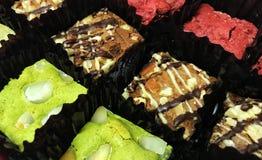 Três sabores das brownies fotos de stock royalty free