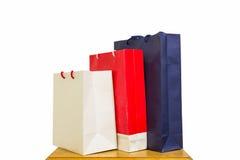 Três sacos de compras isolados no fundo branco Imagem de Stock Royalty Free
