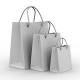 Três sacos shoping no branco Fotografia de Stock