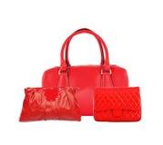 Três sacos vermelhos das mulheres isolados Fotos de Stock
