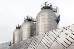 Três silos em de aço inoxidável Imagem de Stock