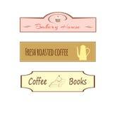Três sinais para um café abrigam, compram, barram Fotografia de Stock Royalty Free