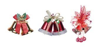 Três sinos de Natal com uma fita vermelha Fotografia de Stock