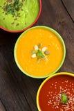 Três sopas frescas em uma tabela de madeira Foto de Stock Royalty Free