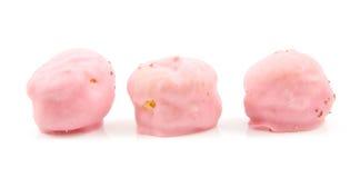 Três sopros de creme cor-de-rosa em uma fileira fotografia de stock royalty free