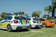 Três sul - carros de polícia africanos em seguido Foto de Stock Royalty Free