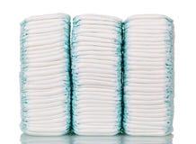 Três tecidos descartáveis das pilhas isolados no branco Fotos de Stock Royalty Free