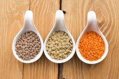 Três tipos da lentilha em umas bacias Imagens de Stock